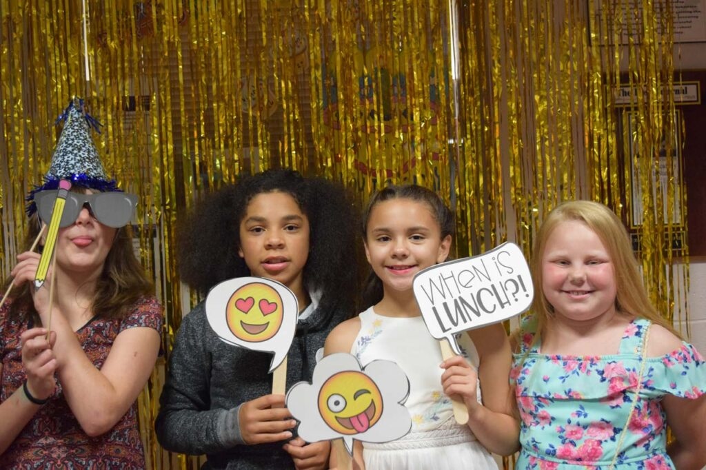 kids in open house photo booth