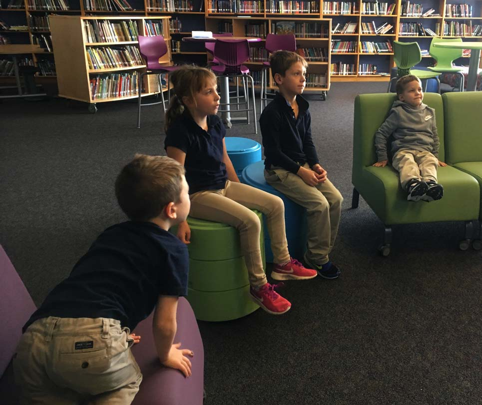elementary students engaged in the circle