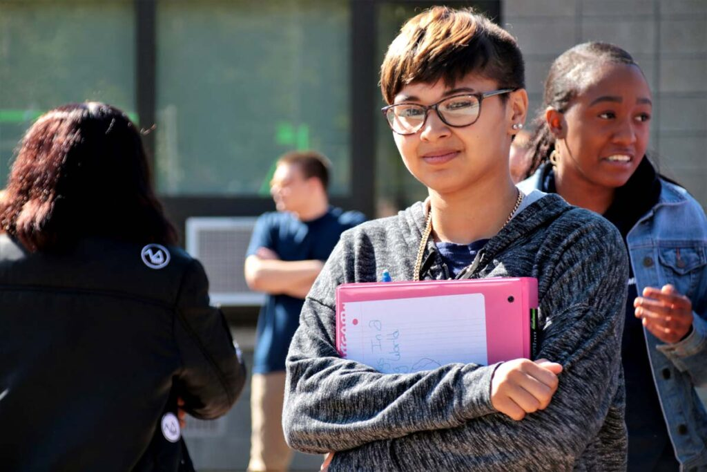 student heading to class holding books